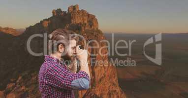 mountain travel, man taking a photo in the montain