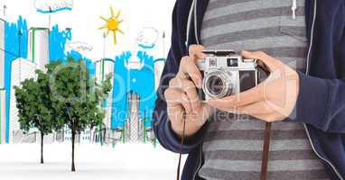 Digitally generated image of male tourist holding camera with buildings drawn in background
