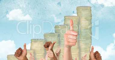 Hands gesturing thumbs up against coin graph