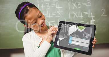 Schoolgirl looking at log in page on tablet PC