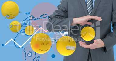 Digital composite image of businessmen holding flying emojis with tech graphics in background