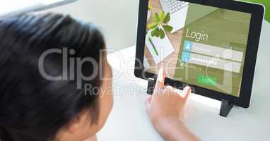 Person touching log in page on digital tablet's screen