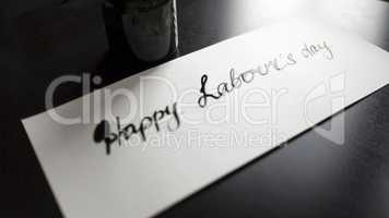 Happy labour's day calligraphy and lattering post card. Left view.