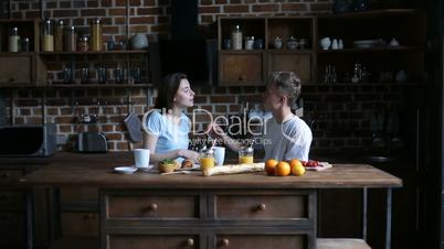 Couple getting ready for day with morning coffee