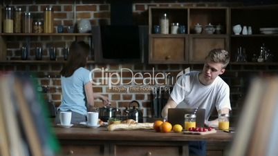 Attractive couple spending leisure in the kitchen