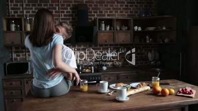 Beautiful romantic couple hugging in the kitchen