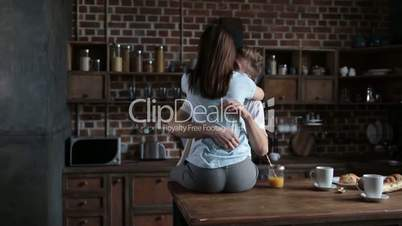 Passionate couple in love embracing in the kitchen