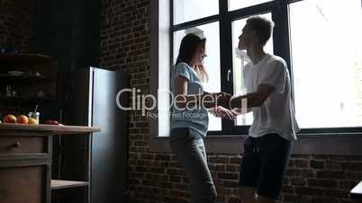 Joyful couple having fun and dancing together