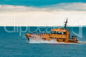 Orange pilot ship