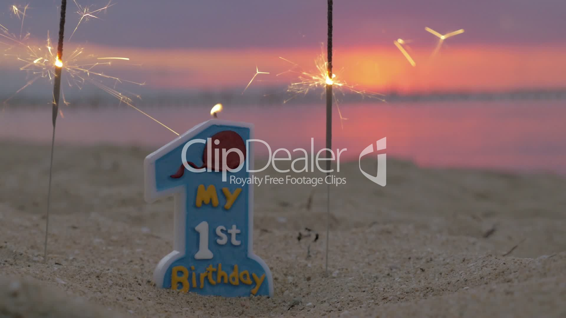 One Year Old Baby Boy Birthday Candle On The Beach Royalty Free