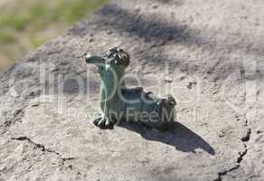 Mini metal sculpture of worm Kukots cartoon character as symbol of fishing photo in Uzhgorod Ukraine