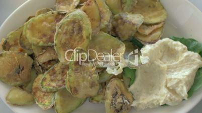Fried zucchini with cream sauce