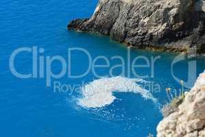 Marine Mycilage near cliffs
