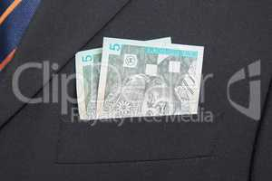 Malaysian Ringgit in the pocket of a suit