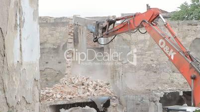 Excavator In Action, demolishing the wall