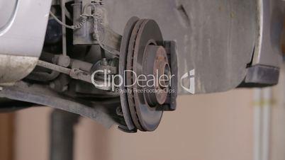 Auto Mechanic Check Repaired Car Wheel