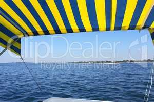 Blue and yellow tent above water surface