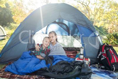 Siblings sitting in the tent