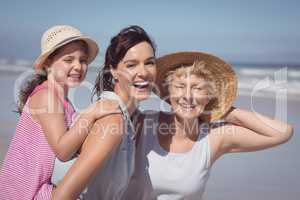Portrait of cheerful multi-generation family at beach
