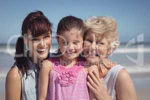 Portrait of happy multi-generation family at beach