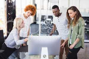 Mature businesswoman explaining colleagues
