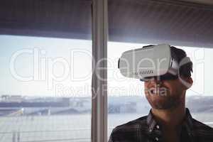 Businessman wearing virtual reality headset in office
