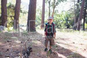 Portrait of boy hiking in forest