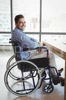Portrait of smiling executive sitting on wheelchair
