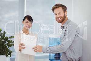 Portrait of smiling executives holding document