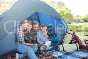 Family taking a selfie in the tent
