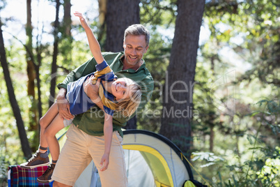 Father and son enjoying on sunny day at campsite