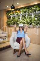 Happy executive using virtual reality headset