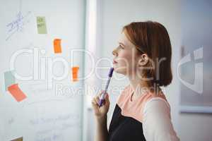 Thoughtful executive reading sticky note