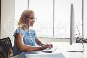 Attentive executive working at personal computer at desk