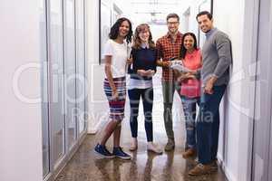 Portrait of business people standing in corridor