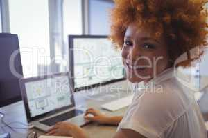 Portrait of female graphic designer working in office