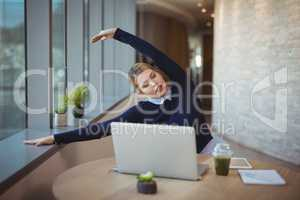 Executive stretching her hands while working