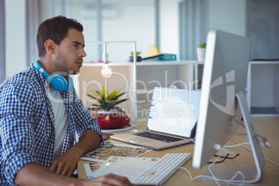 Graphic designer using computer in creative office