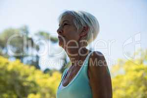 Senior woman standing in the park