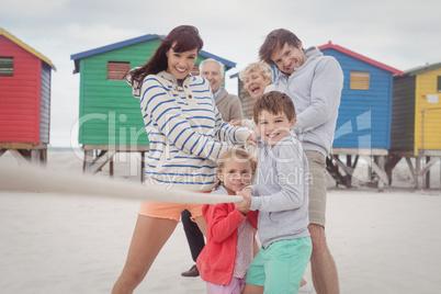 Multi-generation family playing tug of war