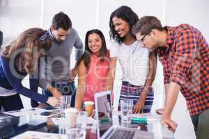 Happy business people discussing in office