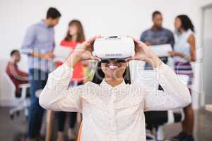 Businesswoman using vr glasses