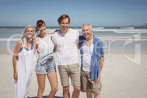 Portrait of happy family standing side by side at beach