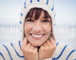 Close up portrait of smiling woman wearing hooded sweater