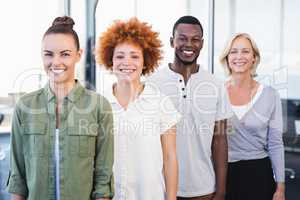 Portrait of smiling business people standing in row