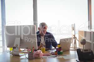 Focused businessman working at office