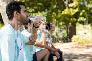 Marathon athletes having water