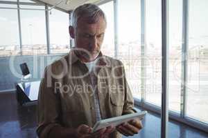 Businessman using digital tablet in modern office