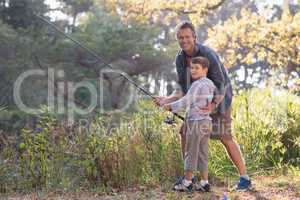 Portait of father and son fishing