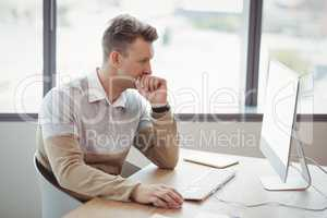 Attentive executive working on personal computer at desk
